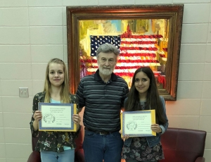 Beth Freudensprung (on left) - Junior Division - 2nd place-- and Naomi Morris (on right) - Junior Division - 2nd HM - receive their certificates and awards from Dennis Patton.