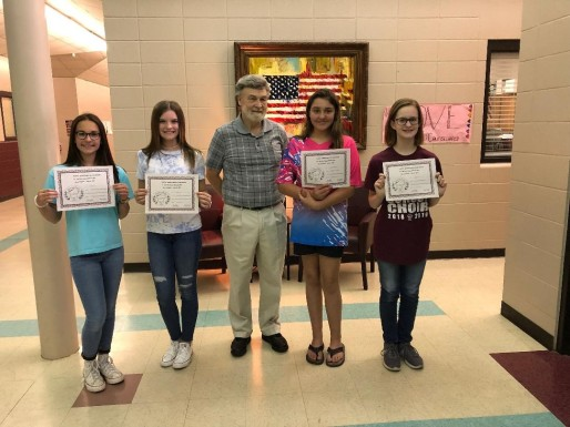 Four Benton Middle School students place in the 2019 Sybil Nash Abrams Student Contest (Junior Division). All four students attend classes under the instruction of Ms. Teresa Bond. (L-R Bella Crowe-2nd Honorable Mention; Addison Glaze-1st Honorable Mention; Dennis Patton, President of PRA; Makayla Blankenship-3rd place; and Mackenzie Burt-2nd place)