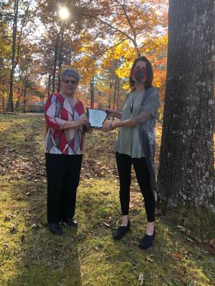 Frieda Patton, President (left), presents the 2020 Poets' Roundtable of Arkansas Merit Award to Stacy Pendergrast (right)
